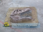 Children simulated archaeological dig site,t-rex skull buried status DWF013-1